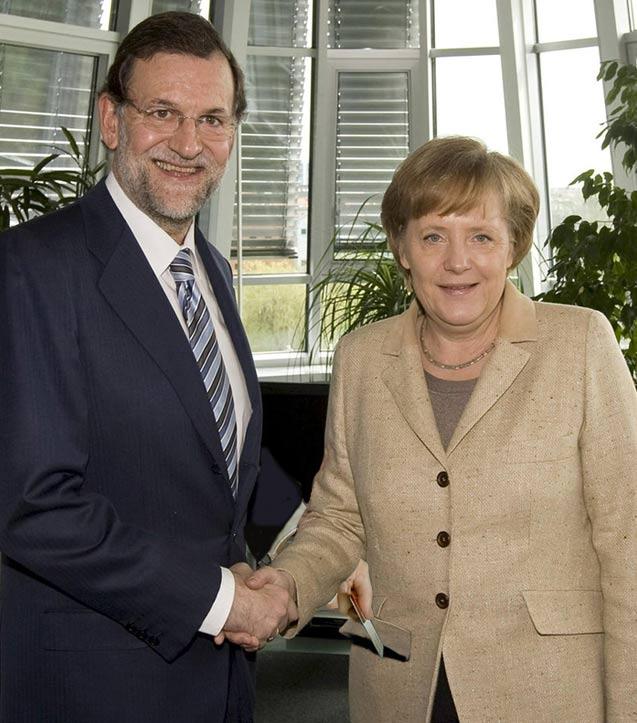 Angela Merkel posa junto a Mariano Rajoy antes de entrar al almuerzo oficial.